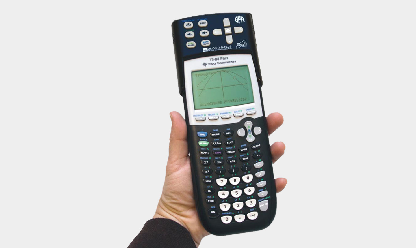 A hand holds up a graphing calculator displaying the front side with a small single-color screen and an extensive array of calculating buttons.