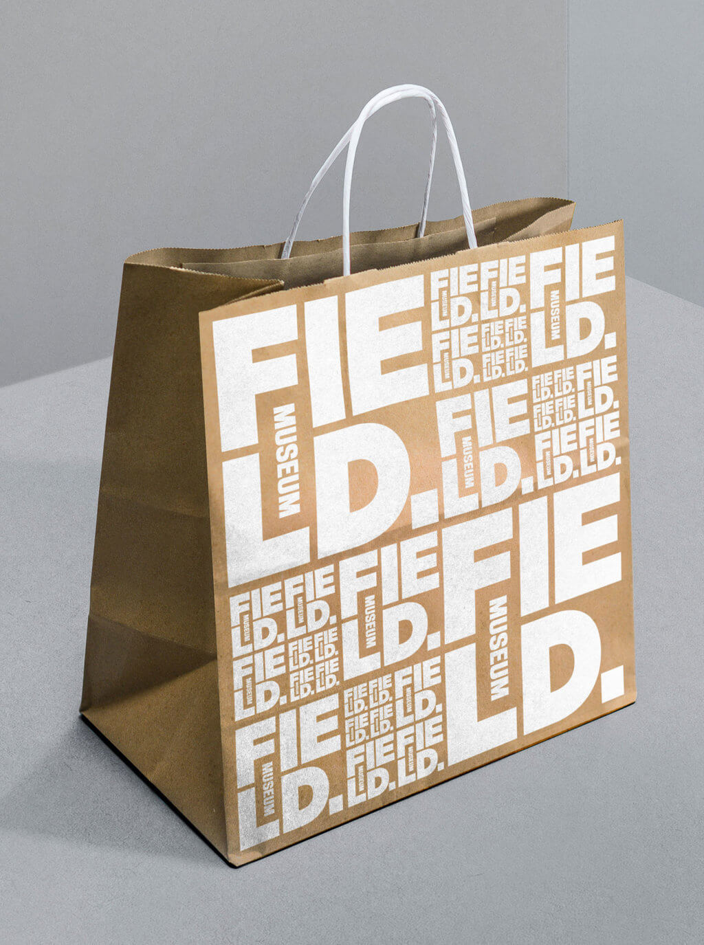 The Field Museum's logo is duplicated multiple times in white to cover the front side of a brown paper shopping bag.